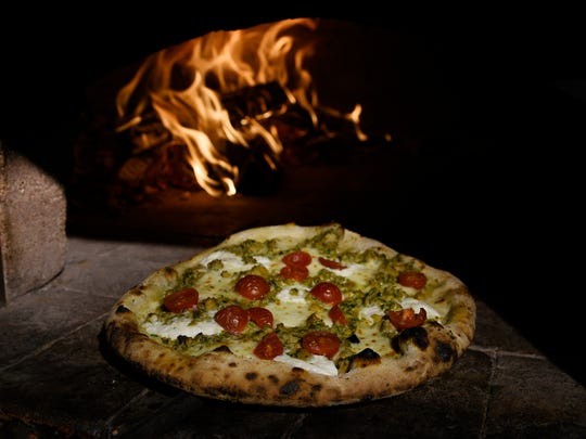 Aquila Pizza al Forno.  Clam pizza on the edge of a wood burning oven.