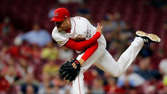 Cincinnati Reds relief pitcher Jared Hughes (48) delivers