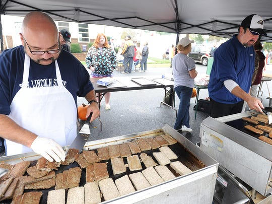 A volunteer cooks scrapple at the 2012 Apple-Scrapple Festival. The Bridgeville celebration is Friday and Saturday. A scrapple-themed brunch will be held Sunday at Grain restaurant in Kennett Square, Pa.