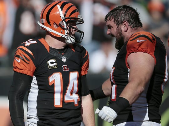 Bengals quarterback Andy Dalton (14) is met by center Russell Bodine (61) in celebration after touchdown in the fourth quarter of the NFL Week 5 game against the Seattle Seahawks.