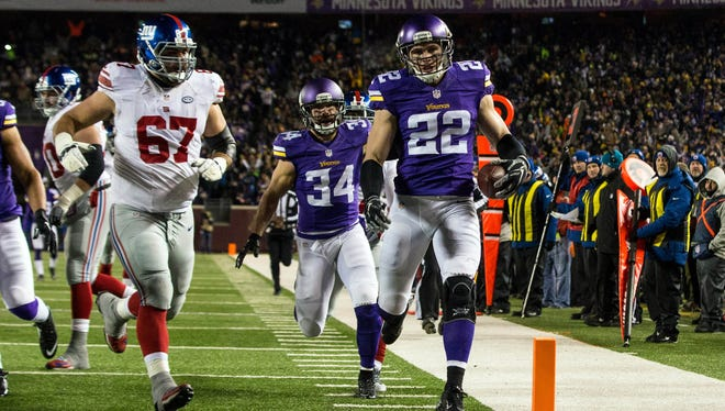 Minnesota Vikings safety Harrison Smith (22) returns an interception for a touchdown during the second quarter against the New York Giants at TCF Bank Stadium.