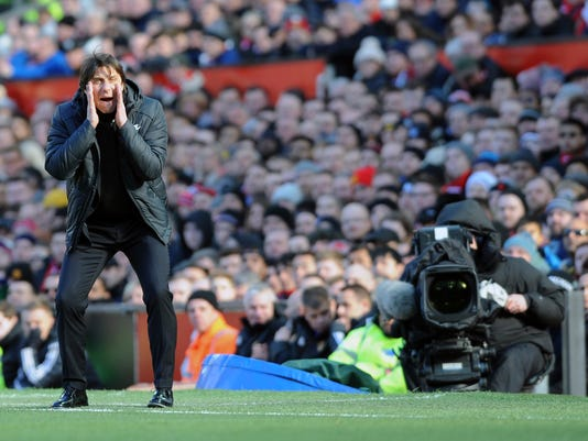 Chelsea's team manager Antonio Conte gives directions to his players during the English Premier League soccer match between Manchester United and Chelsea at the Old Trafford stadium in Manchester, England, Sunday, Feb. 25, 2018. (AP Photo/Rui Vieira)