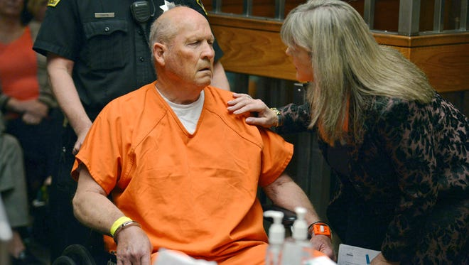 Public defender Diane Howard, right, speaks with Joseph James DeAngelo, 72, who authorities suspect is the so-called Golden State Killer responsible for at least a dozen murders and 50 rapes in the 1970s and 80s, as he makes his initial appearance, April 27, 2018, in Sacramento County Superior Court in Sacramento.