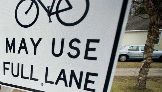 A sign says bicycles may use the full traffic lane on North Avenue in Burlington's New North End.