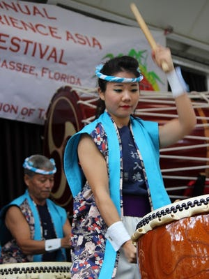 Members of the Matsuriza Taiko Drummers storm the stage at last year's Experience Asia festival.