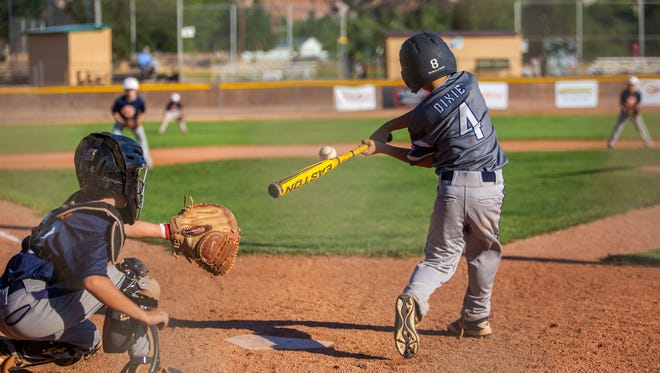A Dixie player swings at a pitch during a game against Snow Canyon in the 2016 Utah Little League All-Star Tournament, Wednesday, July 6.