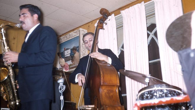 "Larry Covelli (tenor sax) and Tommy Azarello (bass) perform at the Pythodd Club in this circa 1960 photo. According to the photographer, Noal Cohen, both musicians were from Buffalo. ""Musicians from upstate would travel around for gigs,"" Cohen wrote. ""So Syracuse and Buffalo artists would come to Rochester and vice versa."""