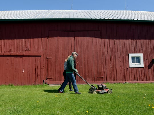 Under a new order from Gov. Gretchen Whitmer, you can mow your own grass, but you can't hire someone to do it for you.