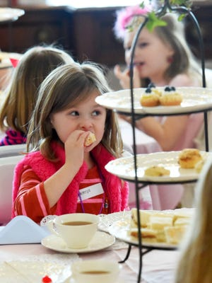 Her cup of tea within easy reach, Camryn Herz, 6, samples one of the many sweets available at her table. The Woodrow Wilson Presidential Library and Museum hosted its annual Victorian ValentineÕs Day Celebration and Tea for young girls and boys at the museum in Staunton on Saturday, Feb. 7, 2015.