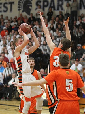 Ripon's Luke Loewe attempts a jumper against   Poynette's defense in the first half at the WIAA semi-final game in West Bend Thursday.