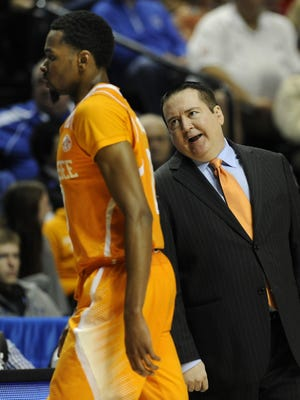 Tennessee coach Donnie Tyndall talks with Kevin Punter (0) as he heads to the bench  during the SEC Tournament game with Arkansas on March 13, 2015 at Bridgestone Arena.