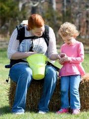 Heather Fredrickson of Staunton helps daughter Emma