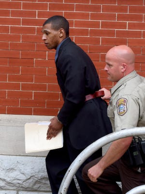 Michael T. Williams is led away by deputies as he leaves the Augusta County Courthouse after being sentenced to 7 years in prison for voluntary manslaughter on Thursday, April 30, 2015.
