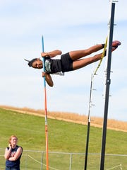 Wilson Memorial's Camaryn Blumears clears 9 feet for the new Conference 36 record as she placed first in the girls pole vault competition at the track and field championships at East Rockingham High School on May 20, 2015.