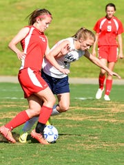 Riverheads' Bess Wood works to take the ball from Robert