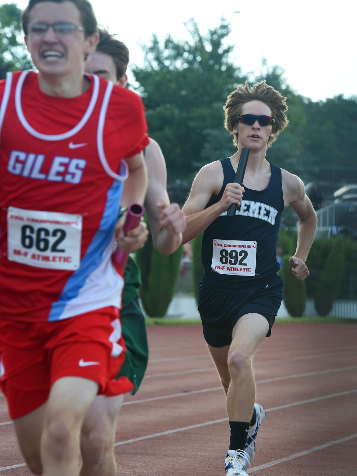 Robert E. Lee's Dylan Wimer races with the baton in the boys' 4x800 meter relay during the first day of the state 2A track championships in Radford on Friday, June 5, 2015.