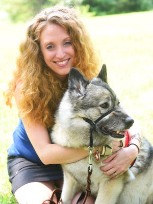 "Kris Church-DiCiccio is both hearing impaired as well as has Reflex Sympathetic Dystrophy type II with Dystonia. Originally trained to serve as a signal service dog, Chara trained herself to depict impending myoclonic dystonic attacks, 15-45 minutes before the episodes. ""She is more than life,"" Kris says of Chara. ""She is my lifeline. Without her, I wouldn't be me."""