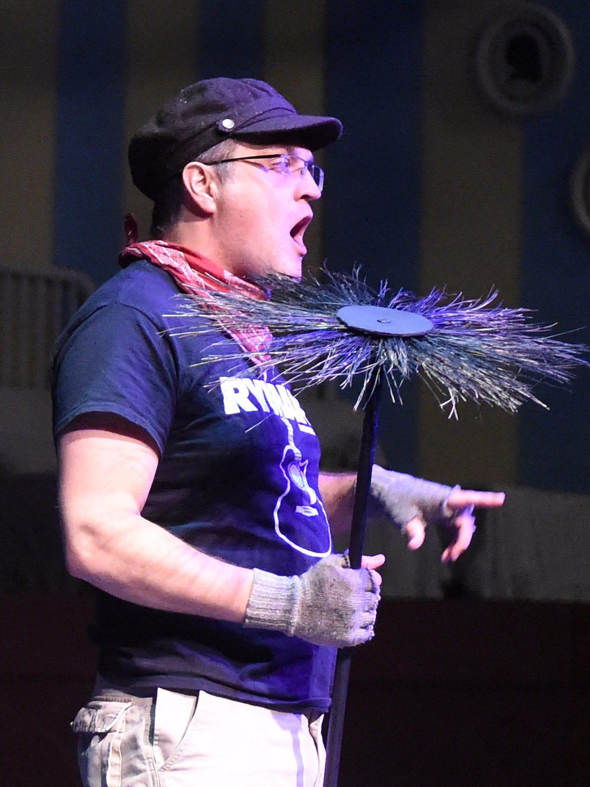 Jeff Ryman holds a prop chimney sweep as he portrays