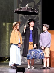 Liz Leone as Mary Poppins shares the stage with Kate Cummings as Jane Banks and Finn Faulconer as Michael Banks during a rehearsal on stage at nTelos Theatre on July 21, 2015.