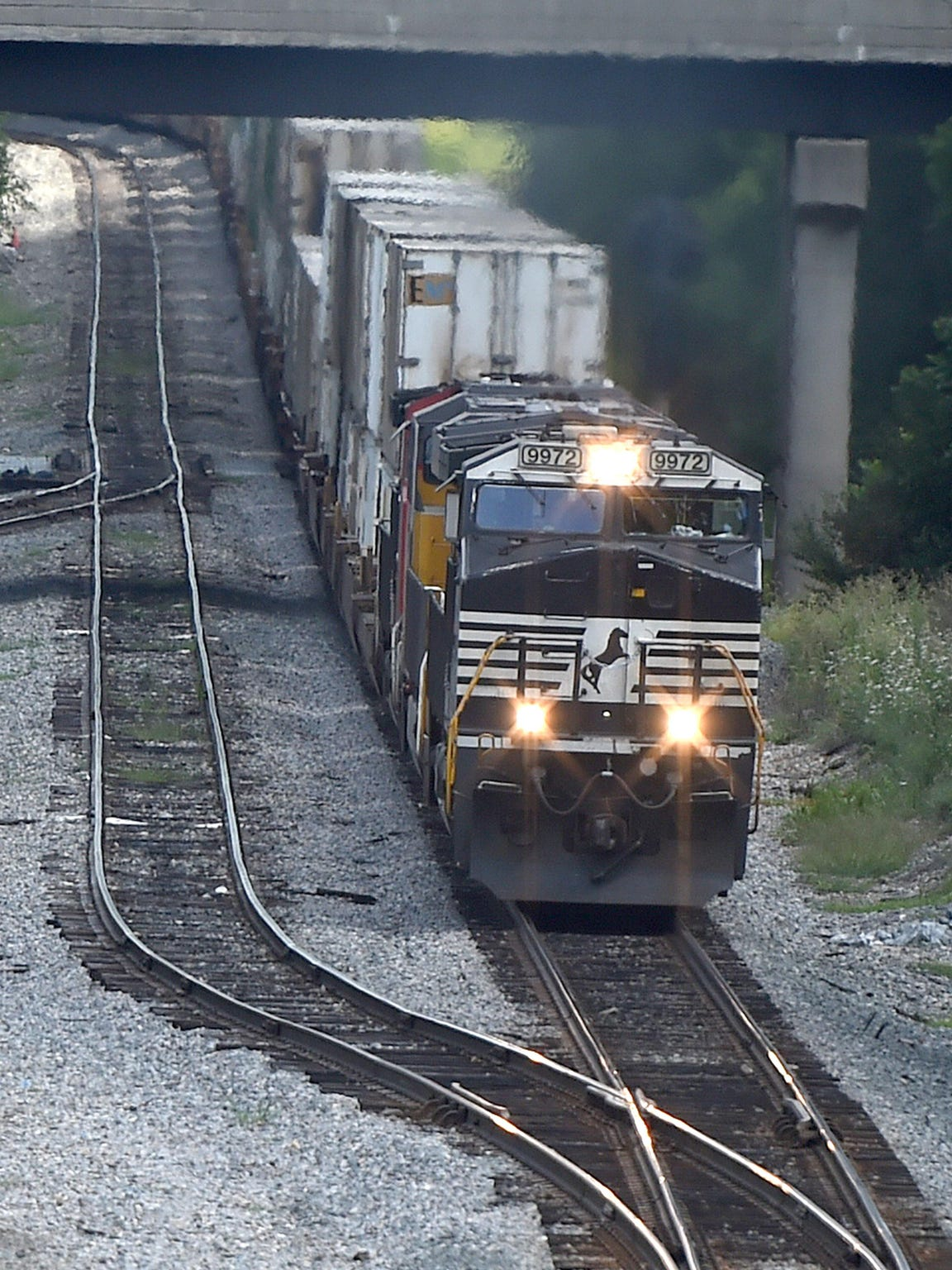 Wrong side of the tracks? A Norfolk Southern locomotive cruises towards the Commerce Avenue area Waynesboro on August 13, 2015. Nearby the tracks an economy of steel is springing up again, this time with classic car renovation and recycling, as well as organic chicken feed and a mini-high-tech corridor.