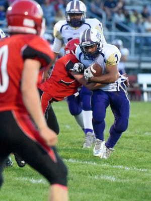 Waynesboro's Marendon Armon Jones struggles for more yards as he is tackled during a football game played in Greenville on Friday, Sept 18, 2015.