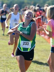 Wilson Memorial's Natalie Prye crosses the finish line in third place in the girls' portion of the Augusta County Cross Country Invitational in Fishersville on Saturday, Sept. 18, 2015.