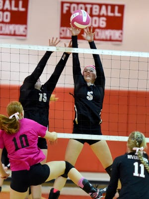 Buffalo Gap's Sierra Clifton (right) blocks a return by Riverheads' Blake Bartley as Buffalo Gap's Camille Ashby backs her up during a volleyball match played in Greenville on Tuesday, Oct. 13, 2015.