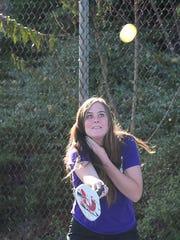 Intern Madison Westmoreland eyes the ball and prepares