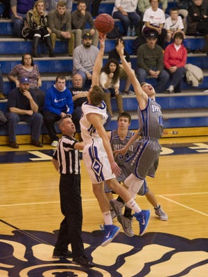 Fort Defiance's Lane McAllister, left, out jumps Spotswood's Kevin Saylor to take first possession of the ball during their basketball game on Tuesday, Dec. 16, 2014.