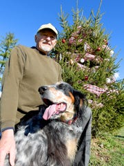 Bob Scates is photographed with his dog, Maddie, next