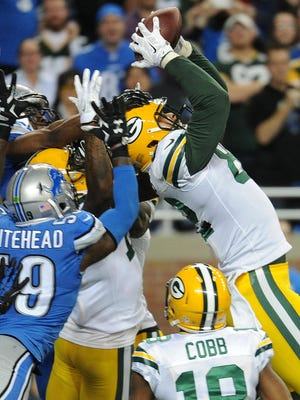 Green Bay Packers tight end Richard Rodgers (82) catches a touchdown on a last second Hail Mary against the Detroit Lions at Ford Field.