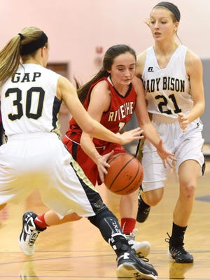 Riverheads' Christa Arehart slips between Buffalo Gap's Destiny Harper and Kieland Chandler with the ball during a basketball game played in Swoope on Saturday, Jan. 2, 2016.