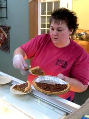 Tammy Johnson plates a slice of pie for a customer during lunch at DoLittle's Diner on U.S. 340 in Stuarts Draft on Wednesday, Feb. 3, 2016. Tammy owns the business with her husband, Billy Ray Johnson.