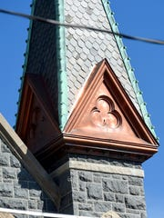 Copper work associated with the spires of St. Francis of Assisi Catholic Church.