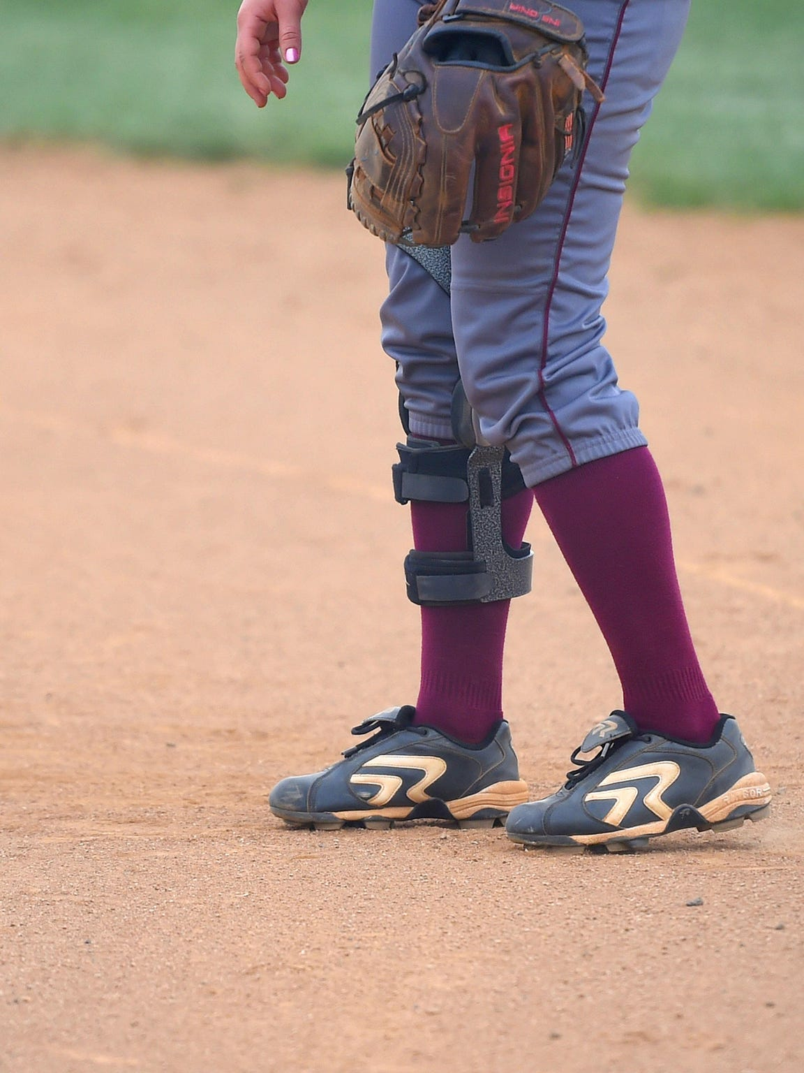 Stuarts Draft's Kayley Campbell wears a brace on her leg during a softball game played in Waynesboro on April 6, 2016.