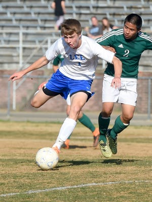 Robert E. Lee's Kyle Stenzel draws back to keep kick the ball during a Conference 36 quarterfinals soccer match in Staunton on Thursday, May 19, 2016.