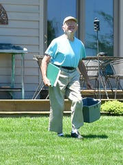 Heading out for a nest check, Mixon Darracott smiles as he looks to his purple martin colony. He carries with him his record book and a bucket for use while cleaning the nests. The task is not considered a chore but a labor of love.