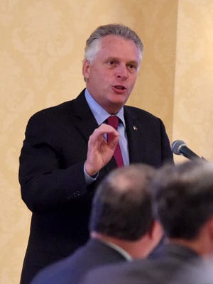 Terry McAuliffe speaks to a business group in July 2015. The former Virginia governor is scheduled to visit Iowa next week as the guest at the first in a series of voter outreach events aimed at encouraging turnout for the Nov. 6 election.