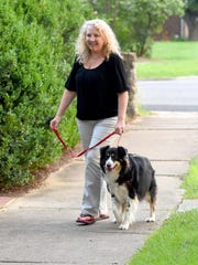 Barbara Blevins walks with her border collie, Hannah, around their neighborhood in Waynesboro on July 20, 2016.