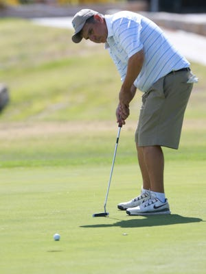 Javier Delgadillo putts on the ninth green Friday at the 75th annual Men's City Championship.