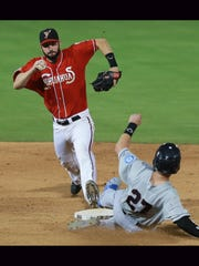 El Paso shortstop Nick Noonan hustles to touch second base ahead of Tacoma's James Ramsey on Saturday. Ramsey was out.