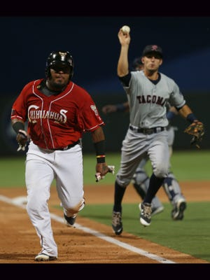 El Paso's Hector Sanchez, left, sprints for home as Tacoma's Zach Shank attempts to put him out Saturday. Sanchez was out at home.