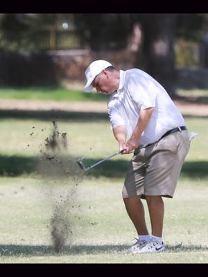 A golfer took his swing to the first green at the Vista Hills Country Club in 2016.