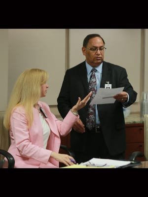 New University Medical Center of El Paso CEO Jacob Cintron examines paperwork with Chief Operating Officer Maria Zampini on Tuesday.
