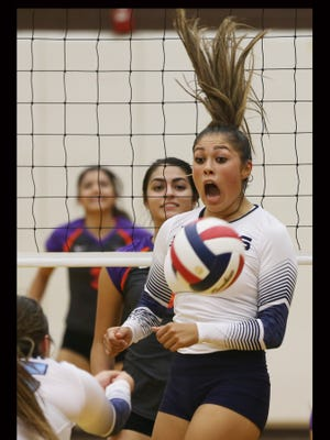 Chapin's Alyssa Lozoya, right, reacts to a free ball during the first game Tuesday.