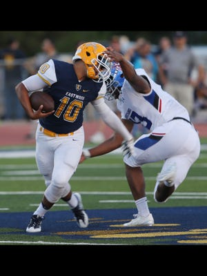 Eastwood quarterback attempts to dodge a tackle attempt by Midland Christian linebacker Ty Russell Friday at Eastwood. Russell was flagged for a personal foul.