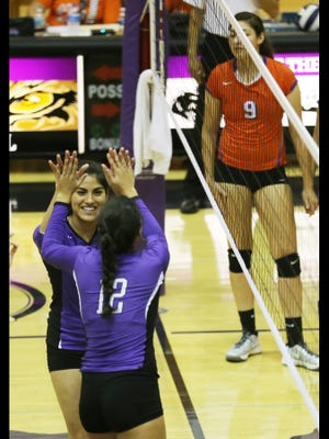 Franklin's Ari Reveles, bottom right, and Brianna Garza, bottom, congratulate each other after a point Saturday. Eastlake's Megan Martinez is at top right.