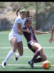 UTEP's Devyn Hunley, left, worked to get around Texas State's Maddie Nichols in order to get the ball Sunday.