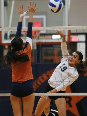 Hanks Alexia Esparza, right, hits the ball over a Riverside defender Tuesday.