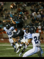 Pebble Hills' Caleb Gerber was unable top hold on to a pass attempt Thursday. A trio of Chapin defenders closed in on him.